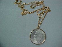 Gold tone necklace with ike dollar in 29 Palms, California